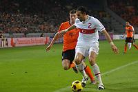 Football - International Friendly The Netherlands vs Turkey. Servet Cetin defends from Klaas Ja Huntelaar