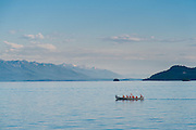 Kalispell Chamber of Commerce Cruise on Far West on Flathead Lake with view of bark canoe / People in a birch bark canoe on Flathead Lake in NW Montana.
