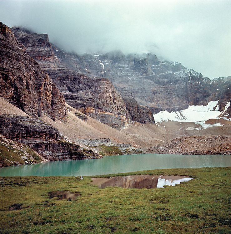 The glacial waters of Lake Opabin, in Yoho National Park, are hues of jade and turquoise, in British Columbia, Canada. ©Ric Ergenbright