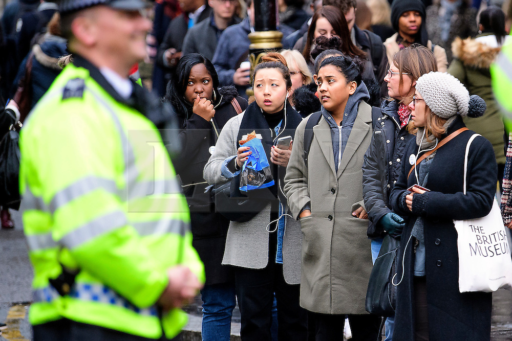 © Licensed to London News Pictures. 09/01/2017. London, UK.  Police watch over long, distressed, queues of commuters waiting for buses at Victoria station in London on the second day of a 24 hour tube strike.  All Zone one tube stations are closed until 6PM tonight after members of the RMT and the Transport Salaried Staffs' Association unions walked out after talks with TFL collapsed. Photo credit: Ben Cawthra/LNP