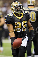 28 November 2011: Runningback (28) Mark Ingram of the New Orleans Saints tosses the ball to the official after a run against the New York Giants during the first half of the Saints 49-24 victory over the Giants at the Mercedes-Benz Superdome in New Orleans, LA.