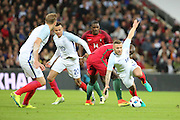 England midfielder, Jack Wilshere (18) getting fouled by Portugal midfielder, Danilo (13) during the Friendly International match between England and Portugal at Wembley Stadium, London, England on 2 June 2016. Photo by Matthew Redman.