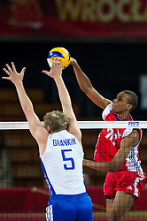 11.09.2014, Centennial Hall, Breslau, POL, FIVB WM, Kuba vs Russland, Gruppe F, im Bild Sergey Grankin russia #5 Osmany Santiago Uriarte Mestre cuba #20 // Sergey Grankin russia #5 Osmany Santiago Uriarte Mestre cuba #20 during the FIVB Volleyball Men's World Championships 2nd Round Pool F Match beween Cuba and Russia at the Centennial Hall in Breslau, Poland on 2014/09/11. EXPA Pictures © 2014, PhotoCredit: EXPA/ Newspix/ Sebastian Borowski<br /> <br /> *****ATTENTION - for AUT, SLO, CRO, SRB, BIH, MAZ, TUR, SUI, SWE only*****