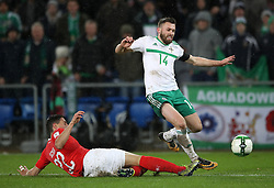 Switzerland's Fabian Schar (left) slides in to challenge Northern Ireland's Stuart Dallas during the FIFA World Cup Qualifying second leg match at St Jakob Park, Basel.