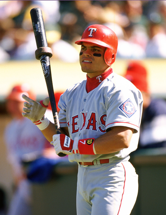 OAKLAND - 1994:  Ivan Rodriguez of the Texas Rangers looks on during an MLB game against the Oakland Athletics at the Oakland-Alameda County Coliseum during the 1994 season. (Photo by Ron Vesely).  Subject:   Ivan Rodriguez