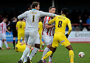 Cheltenham and Plymouth players have a scuffle during the Sky Bet League 2 match between Cheltenham Town and Plymouth Argyle at Whaddon Road, Cheltenham, England on 28 March 2015. Photo by Alan Franklin.