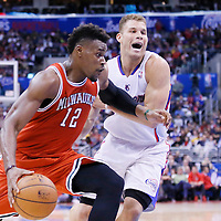 24 March 2014: Milwaukee Bucks forward Jeff Adrien (12) drives past Los Angeles Clippers forward Blake Griffin (32) during the Los Angeles Clippers 106-98 victory over the Milwaukee Bucks at the Staples Center, Los Angeles, California, USA.