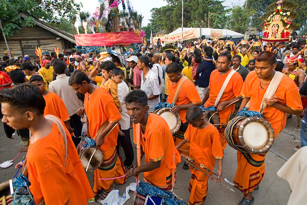 "Malaysian Hindu devotees celebrates the Thaipusam festival in Kuala Lumpur, Malaysia. Hindu devotees celebrate Thaipusam festival in honour of the Lord Murugan (also known as Lord Subramaniam). Thousands of Hindu devotees carried the milk pots and ""kavadi"" (a gaily decorated wooden or metal frame) walk barefoot up the temple's 272 steps to undergo penance in fulfilling vows made to Lord Murugan for answering their prayers."