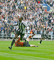 Photo: Andrew Unwin.<br />Newcastle United v Wigan Athletic. The Barclays Premiership. 19/08/2006.<br />Newcastle's Shola Ameobi celebrates scoring his team's second goal.