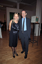 IWONA BLAZWICK Director of the Whitechapel Gallery and SIR NICHOLAS SEROTA at a party to celebrate the opening of the new Whitechapel Gallery, 77-82 Whitechapel High Street, London E1 on 2nd April 2009.