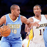 23 November 2014: Denver Nuggets guard Arron Afflalo (10) drives past Los Angeles Lakers forward Wesley Johnson (11) on a screen set by Denver Nuggets center JaVale McGee (34) during the Los Angeles Lakers season game versus the Denver Nuggets, at the Staples Center, Los Angeles, California, USA.