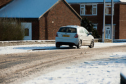 Car parked in the snow on Minster Road Ecclesfield in North Sheffield .5 February 2013.Image © Paul David Drabble