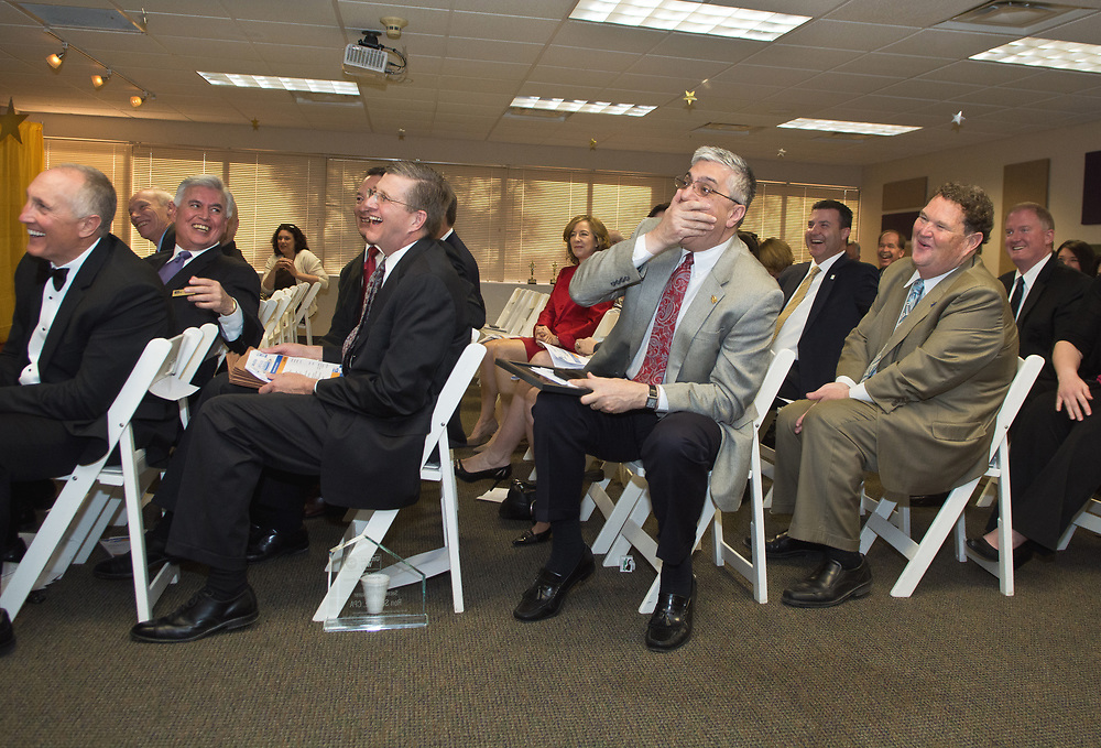 mkb031117e/metro/Marla Brose<br /> Chaouki Abdullah, University of New Mexico's interim president, covers his mouth after blurting out, &quot;La La Land&quot;, as winners of the United Way of Central New Mexico campaign are announced during the annual meeting and Albuquerque, N.M., March 14, 2017. The University of New Mexico was recognized as being in the top five for their employee contributions to United Way.  (Marla Brose/Albuquerque Journal)