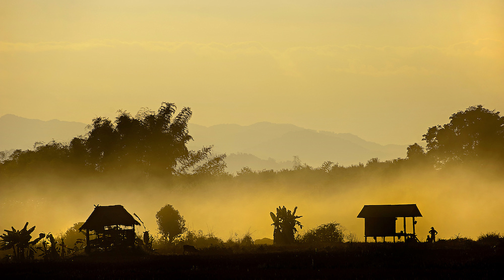 A smokey sunset over the rice fields in Luang Namtha, Laos.