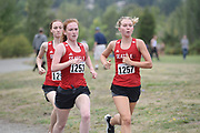 Delaney Griffin (1253) and Ellie Postma (1257) of Seattle University run together in the women's 3 mile run at the UW/Seattle University Open meet at Warren G. Magnuson Park., Friday, Aug. 30, 2019, in Seattle. (Paul Merca/Image of Sport)