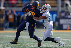 BERKELEY, CA - DECEMBER 01: Fullback Malik McMorris #99 of the California Golden Bears breaks a tackle from linebacker Bobby Okereke #20 of the Stanford Cardinal during the second quarter at California Memorial Stadium on December 1, 2018 in Berkeley, California. (Photo by Jason O. Watson/Getty Images) *** Local Caption *** Malik McMorris; Bobby Okereke