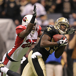 16 January 2010: New Orleans Saints wide receiver Devery Henderson (19) catches a touchdown over Arizona Cardinals cornerback Bryant McFadden (25) during the first half of the 2010 NFC Divisional Playoff game at the Louisiana Superdome in New Orleans, Louisiana.