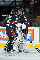 KELOWNA, CANADA -FEBRUARY 5: Taz Burman G #30 of the Red Deer Rebels passes teammate Patrik Bartosak #35 as the Red Deer Rebels make a goalie change in the first period against the Kelowna Rockets on February 5, 2014 at Prospera Place in Kelowna, British Columbia, Canada.   (Photo by Marissa Baecker/Getty Images)  *** Local Caption *** Taz Burman; Patrik Bartosak;