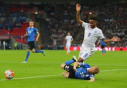 Raheem Sterling of England is challenged by Taijo Teniste of Estonia - Mandatory byline: Paul Terry/JMP - 07966 386802 - 09/10/2015 - FOOTBALL - Wembley Stadium - London, England - England v Estonia - European Championship Qualifying - Group E