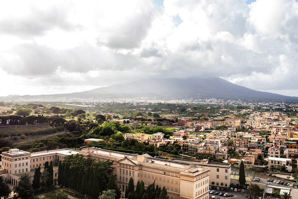 A view of the city of Pompeii from over the top of belfry of the Sanctuary of the Madonna of the Rosary, Pompeii. behind the scene the Vesuvius con other cities around.