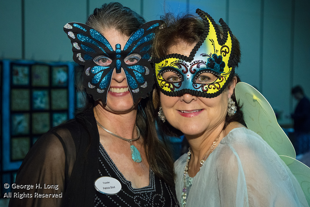 """Patricia Stout and Sally Buras; The Women's Center for Healing and Transformation """"An Evening of Masquerade"""" fifth annual fundraising gala at the Castine Center in Mandeville, Louisiana on March 31, 2017"""