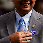 Mayoral candidate David Alvarez displays his voting stickers at a rally for his supporters in Kearny Mesa.