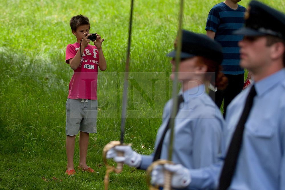 © Licensed to London News Pictures. 27/06/2012. LONDON, UK. A young boy takes pictures of as members of the RAF march past during a rehearsal for the opening ceremony of the newly built RAF Bomber Command memorial in Green Park London today (27/06/12). The memorial commemorates the 55,573 airmen lost flying bomber aircraft during the Second World War and will be opened officially by the Queen on the 28th of June.  Photo credit: Matt Cetti-Roberts/LNP