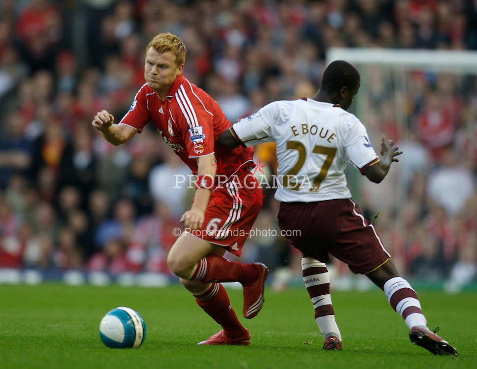 LIVERPOOL, ENGLAND - Sunday, October 28, 2007: Liverpool's John Arne Riise and Arsenal's Emmanuel Eboue during the Premiership match at Anfield. (Photo by David Rawcliffe/Propaganda)