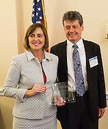 Presentation of award to Representative Kathy Castor (D-FL) by Dr. Bill Dalton, PhD, MD, CEO of M2Gen during the Hill Day reception held at Rayburn House Office Building in Washington, DC, on Wednesday, May 11, 2016. The American Association for Cancer Research (AACR), the Association of American Cancer Institutes (AACI), and the American Society of Clinical Oncology (ASCO) honored U.S. Representatives Kathy Castor (D-Fla.) and Chuck Fleischmann (R-Tenn.) for their outstanding leadership on behalf of cancer research during the reception. (Alan Lessig/)