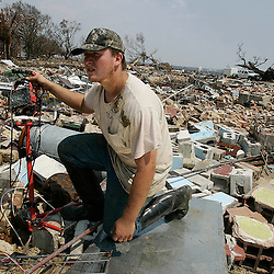 Kelvin Schulz II looks for anything left from his family home where his 80 year-old grandmother Jane Mollere was killed during the hurricane on Washington St. in Bay St. Louis during the aftermath of Hurricane Katrina Monday, September 5, 2005 in Mississippi. <br /> (Pasadena Star-News Keith Birmingham)
