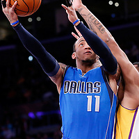12 April 2014: Dallas Mavericks guard Monta Ellis (11) goes for the layup against Los Angeles Lakers guard Jabari Brown (15) during the Dallas Mavericks 120-106 victory over the Los Angeles Lakers, at the Staples Center, Los Angeles, California, USA.