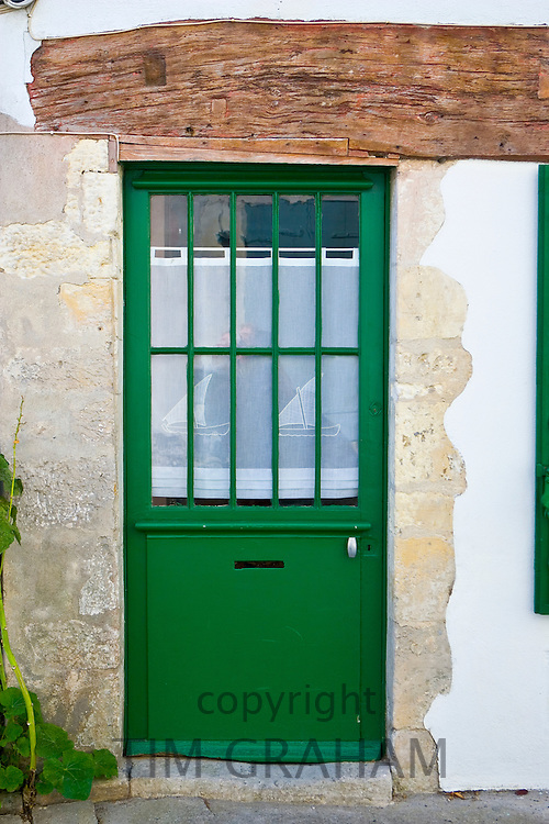 Door with net panel, Ile De Re, France.