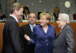 "Angela Merkel, Germany's chancellor, center, introduces Guido Westerwelle, her new foreign minister, to Dimitris Christofias, president of Cyprus, right as Markos Kyprianou, the foreign minister of Cyprus, looks on from behind, during the European Union Summit at the EU headquarters in Brussels, Belgium, on Thursday, Oct. 29, 2009. European Union leaders are set for ""very difficult"" talks to overcome the Czech Republic's resistance to a new governing treaty designed to strengthen the EU's influence in world affairs, Reinfeldt said. (Photo © Jock Fistick)"