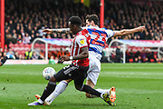 Brentford Midfielder Moses Odubajo (2) and Queens Park Rangers Midfielder Pawel Wszolek (23) in action during the EFL Sky Bet Championship match between Brentford and Queens Park Rangers at Griffin Park, London, England on 2 March 2019.