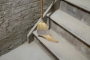 just swept dusty stairwell with old intense used old style straw broom