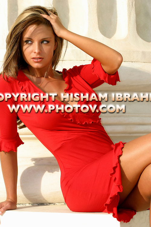 Sexy Young Woman Wearing a Short Red Dress.