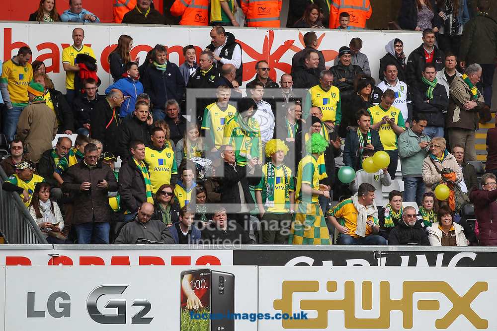 The traveling Norwich fans before the Barclays Premier League match at the Liberty Stadium, Swansea<br /> Picture by Paul Chesterton/Focus Images Ltd +44 7904 640267<br /> 29/03/2014