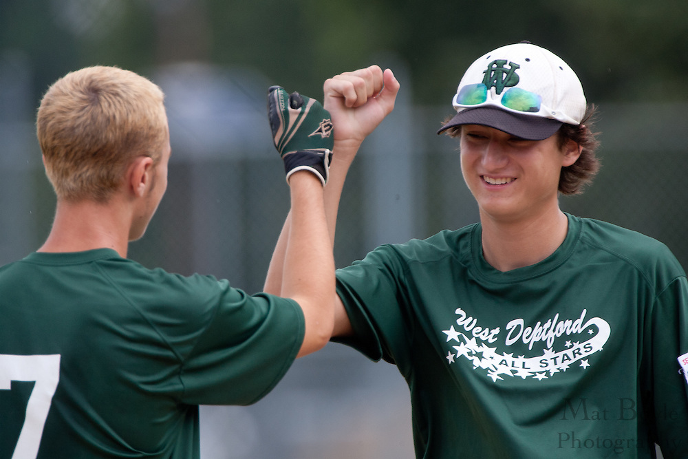 West Deptford's Brendan Glass (r) is greeted by Ty Castellano during introductions before a elimination bracket game of the Eastern Regional Senior League tournament held in West Deptford on Sunday, August 7.