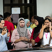 MARAWI, PHILIPPINES - JUNE 4: Residents call their family in Provincial Capitol Complex while government troops are trying to recover families who are left behind inside the conflict area of Marawi City in southern Philippines, June 4, 2017. Philippine Arm Forces and Marines continue to advance their positions as more soldiers reinforce to fight the Maute group in Marawi City, Mindanao, Philippines. (Photo: Richard Atrero de Guzman/ANADOLU Agency)