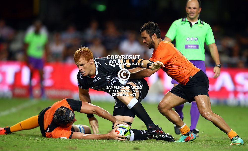 DURBAN, SOUTH AFRICA - MARCH 05: Guido Petti of the Jaguares gets the ball back to Martin Landajo of the Jaguares as Phillip van der Walt of the Cell C Sharks looks to make a tackle during the 2016 Super Rugby match between Cell C Sharks and Jaguares at Growthpoint Kings Park Stadium on March 05, 2016 in Durban, South Africa. (Photo by Steve Haag/Gallo Images)