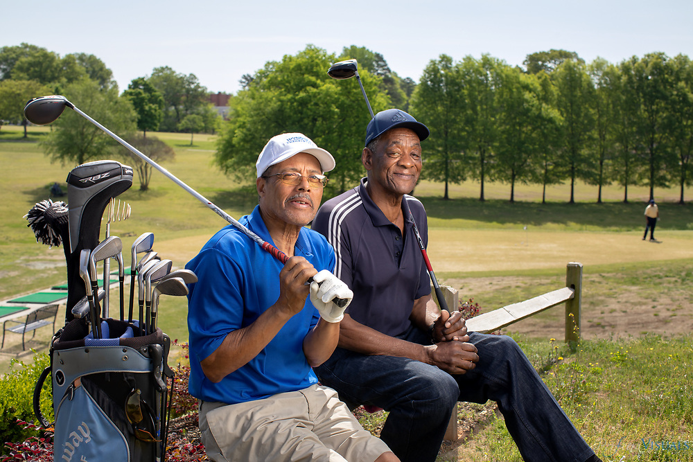 Jimmy Moore, left, with his friend and brother-in-law Fred Pritchett near the practice range of Gillespie Golf Course, a Greensboro Parks and Recreation course. Pritchett was on the course as a caddy the day that late Dr. George Simkins Jr. and five other African-Americans played nine holes on the &quot;whites only&quot; course December 7, 1955. The Greensboro Six eventually had their sentences commuted by Governor Luther Hodges.<br /> <br /> Photographed, Thursday, May 3, 2018, in Greensboro, N.C. JERRY WOLFORD and SCOTT MUTHERSBAUGH / Perfecta Visuals