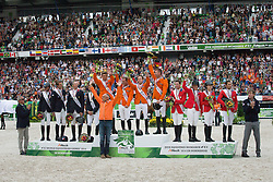 Team Netherlands, World Champions, Jeroen Dubbeldam, gerco Schroder, Maikel Van Der Vleuten, Jur Vrieling, chef d'equipe Rob Ehrens, , World Champions, - Second Round Team Competition - Alltech FEI World Equestrian Games™ 2014 - Normandy, France.<br /> © Hippo Foto Team - Leanjo De Koster<br /> 25/06/14