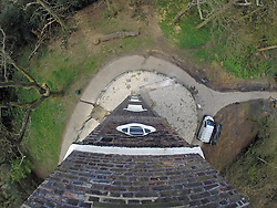 © Licensed to London News Pictures. 14/04/2014. The 60ft drop from Severndroog Castle. A 18th century castle on a hill in south east London is preparing to reopen as its restoration nears completion. Severndroog Castle in Oxleas Woods on Shooters Hill enjoys stunning views across five counties. The folly has been closed for many years and was in state of disrepair before work started on a restoration project last year. The historic building featured in the BBC series Restoration in 2004. Reopening date yet to be confirmed, more information available fron the Severndroog Castle Building Presevation Trust . Credit : Rob Powell/LNP