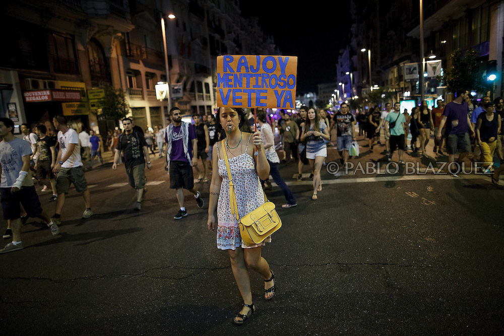 Protestors take the streets during a demonstration against the Spanish government, on Thursday, July 18, 2013, in Madrid, Spain. Placard reads 'Rajoy liar. Go away now'. Thousands demonstrators demanding the resignation of Prime Minister Mariano Rajoy and its party gathered in front of the People's Party headquarter. Rajoy rejected demands to resign after more alleged secret payments and test messages related to former political party treasurer Luis Barcenas under investigation appeared. The spectacle of alleged greed and corruption has enraged Spaniards hurting from austerity and sky high unemployment.