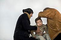 ©WEST BANK 2007. Israeli doctor from Physicians for Human Rights examine a boy. PHR sets up free clinics on the West Bank on weekends..Picture featured in book KIDS photos by Markus Marcetic, published 2007.