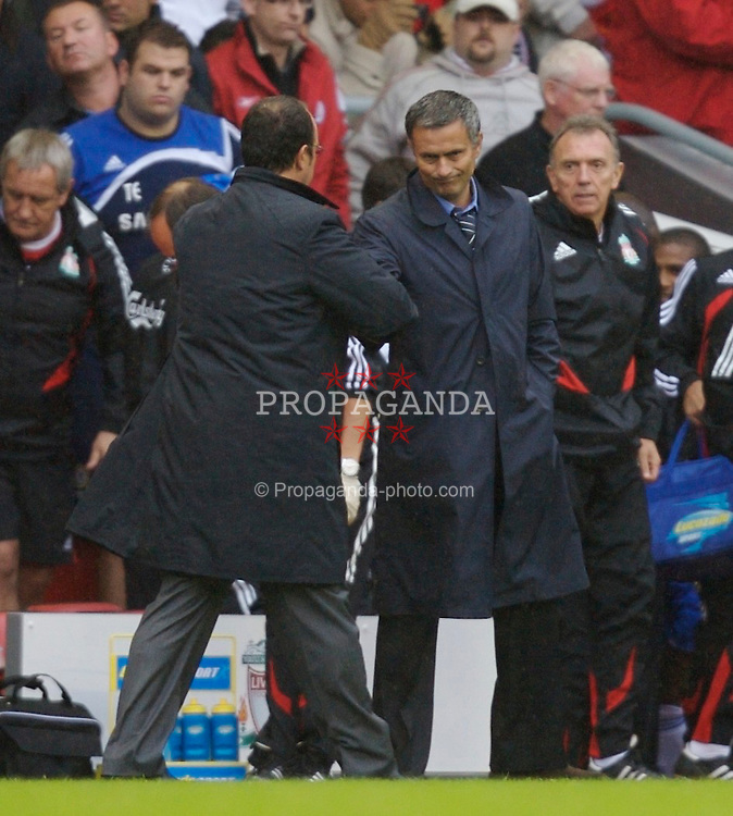 Liverpool, England - Sunday, August 19, 2007: Chelsea's manager Jose Mourinho, who's side gained a point thanks to a very suspicious performance from the referee, offers his hand to Liverpool's manager Rafael Benitez after the Premiership match at Anfield. (Photo by David Rawcliffe/Propaganda)