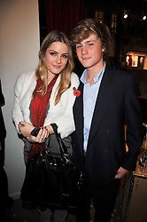 The HON.PHILIPPA CADOGAN and ALEXANDER VAUGHAN at the launch party of 'Songs For Sorrow' hosted by Alber Elbaz and Mika held at Lanvin, 32 Savile Row, London on 11th November 2009.
