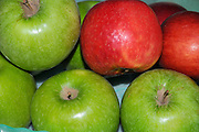 a stack of Green and red apples