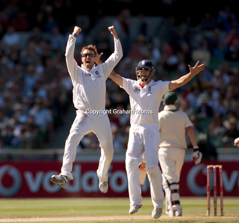 Graeme Swann (left) celebrates taking the wicket of Michael Clarke during the fourth Ashes test match between Australia and England at the MCG in Melbourne, Australia. Photo: Graham Morris (Tel: +44(0)20 8969 4192 Email: sales@cricketpix.com) 28/12/10