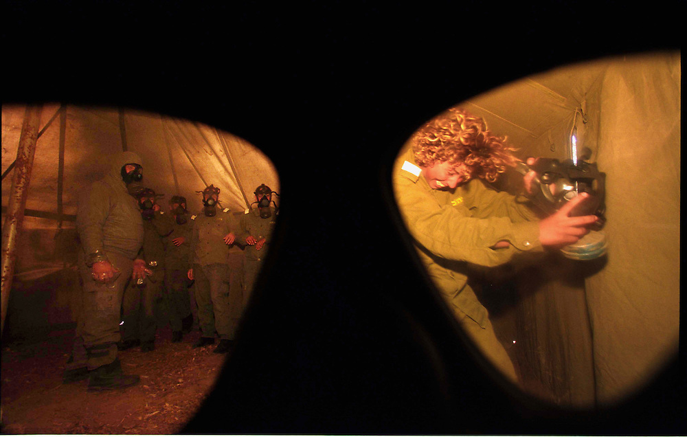sraeli soldiers training with gas mask in a gas tent .this soldiers supposed to help the civilian in a time of chemical war in affected area..Israel Ashkelon 01.07.02..